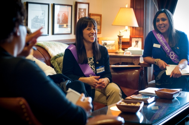 Caregiver & Alzheimer's Association Board Member Mikaela Louie speaks with   a staffer from  Sen. Tim Sheldon's office during Advocacy Day.
