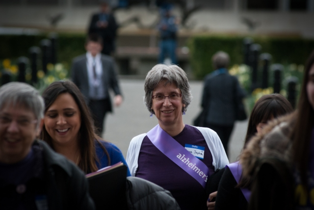 Irene crosses the street with her advocacy team during Advocacy Day.  A former physician, Irene now tells her story of being diagnosed with Early Onset Alzheimer's.