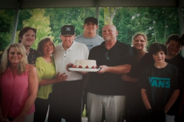 The family celebrates Papaw Gene's birthday with a cake. Over 5 million Americans are currently living with Alzheimer's, including Gene Wilhelm, maternal grandfather of J.R. Sweezy.