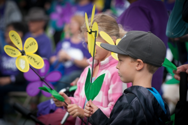 Children hold flowers in honor of loved ones at the Seattle Walk to End Alzheimer's.