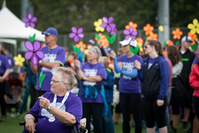 Participants hold flowers during the ceremony at the Seattle Walk to End Alzheimer's.