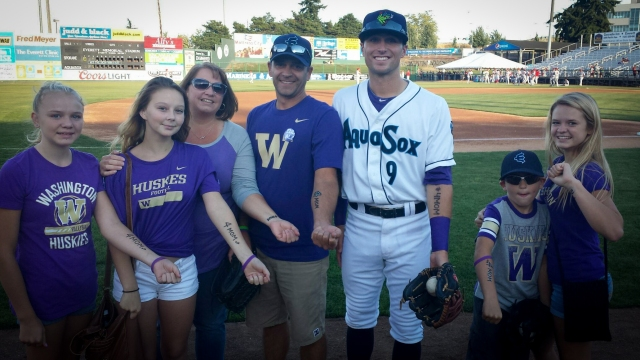 The Holscher family pose with AquaSox's Braden Bishop during Alzheimer's Awareness night at the AquaSox Stadium. The Holschers have joined Braden's #4MOM Walk to End Alzheimer's team walking in Everett on October 3, 2015.