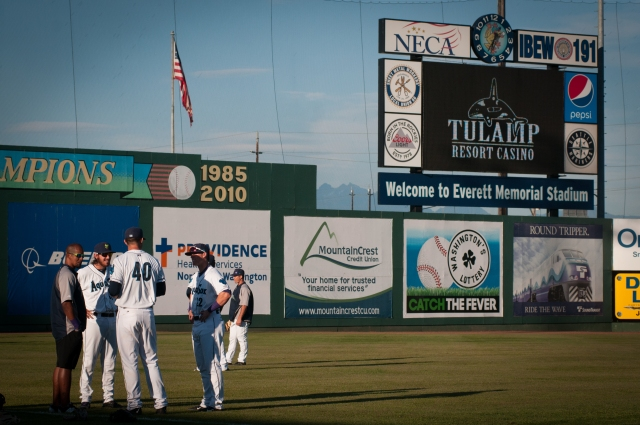 AquaSox players talk before playing at the stadium in Everett. The players wrote #4MOM on their equipment and arms in honor of Braden Bishop's mom who has early onset Alzheimer's.