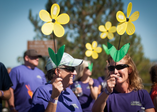 Walkers hold yellow flowers at the Walla Walla Walk to End Alzheimer's on September 20, 2015. The yellow flowers represent caring or supporting someone with Alzheimer's.