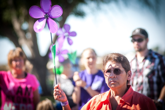 Teresa Gutierrez holds a purple flower at the Walla Walla Walk to End Alzheimer's on September 20, 2015.